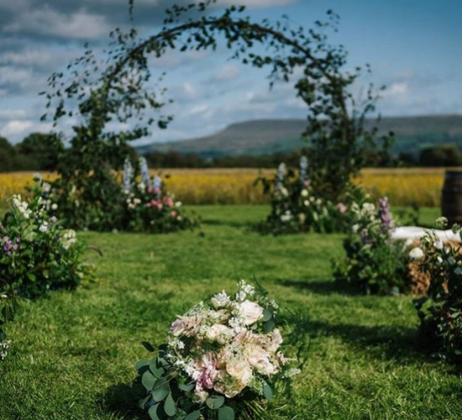 2.7m meadow arch - outdoor ceremony with no lighting - floral